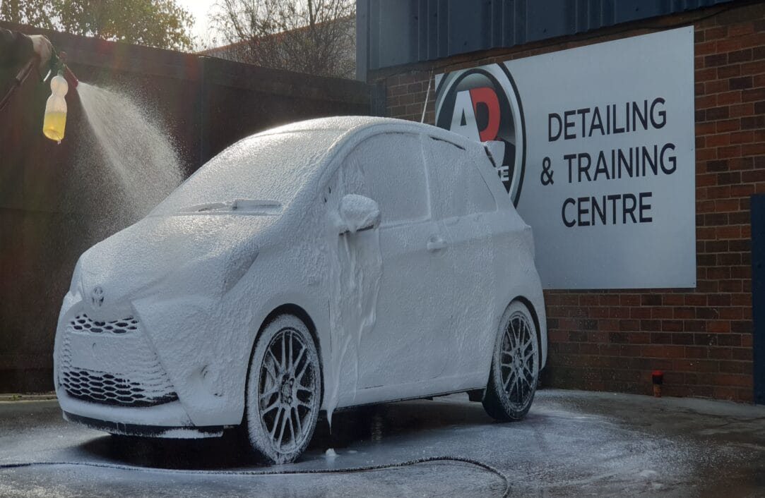 Car with cleaning product on